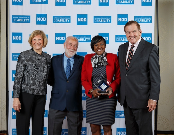 , posing with the 2018 Leading Disability Employer award, with Gov. Tom Ridge, actor Robert David Hall and NOD President Carol Glazer