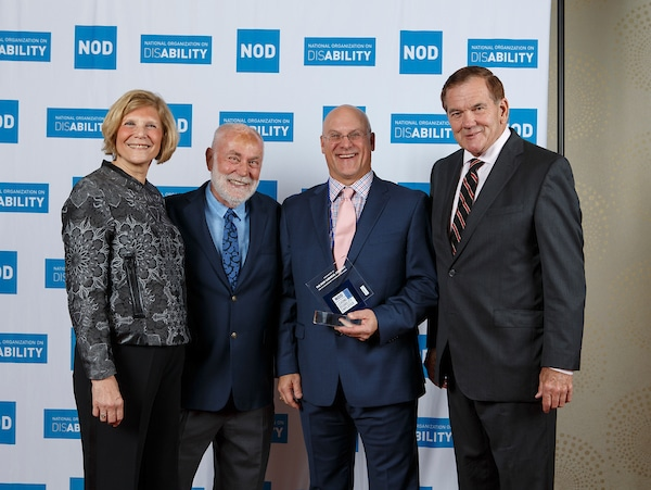 Dow's Jim Strunk, posing with the 2018 Leading Disability Employer award, with Gov. Tom Ridge, actor Robert David Hall and NOD President Carol Glazer