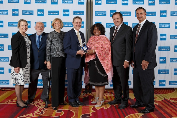 Northrop Grumman's Wesley Bush, Kymberlee Dwinell, Sandra Evers-Manly and colleague, posing with the 2018 Leading Disability Employer award, with Gov. Tom Ridge, actor Robert David Hall and NOD President Carol Glazer