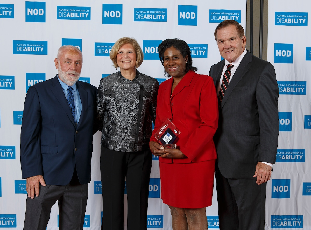The Hartford Financial Services Group's Renee Johnson, posing with the 2018 Leading Disability Employer award, with Gov. Tom Ridge, actor Robert David Hall and NOD President Carol Glazer