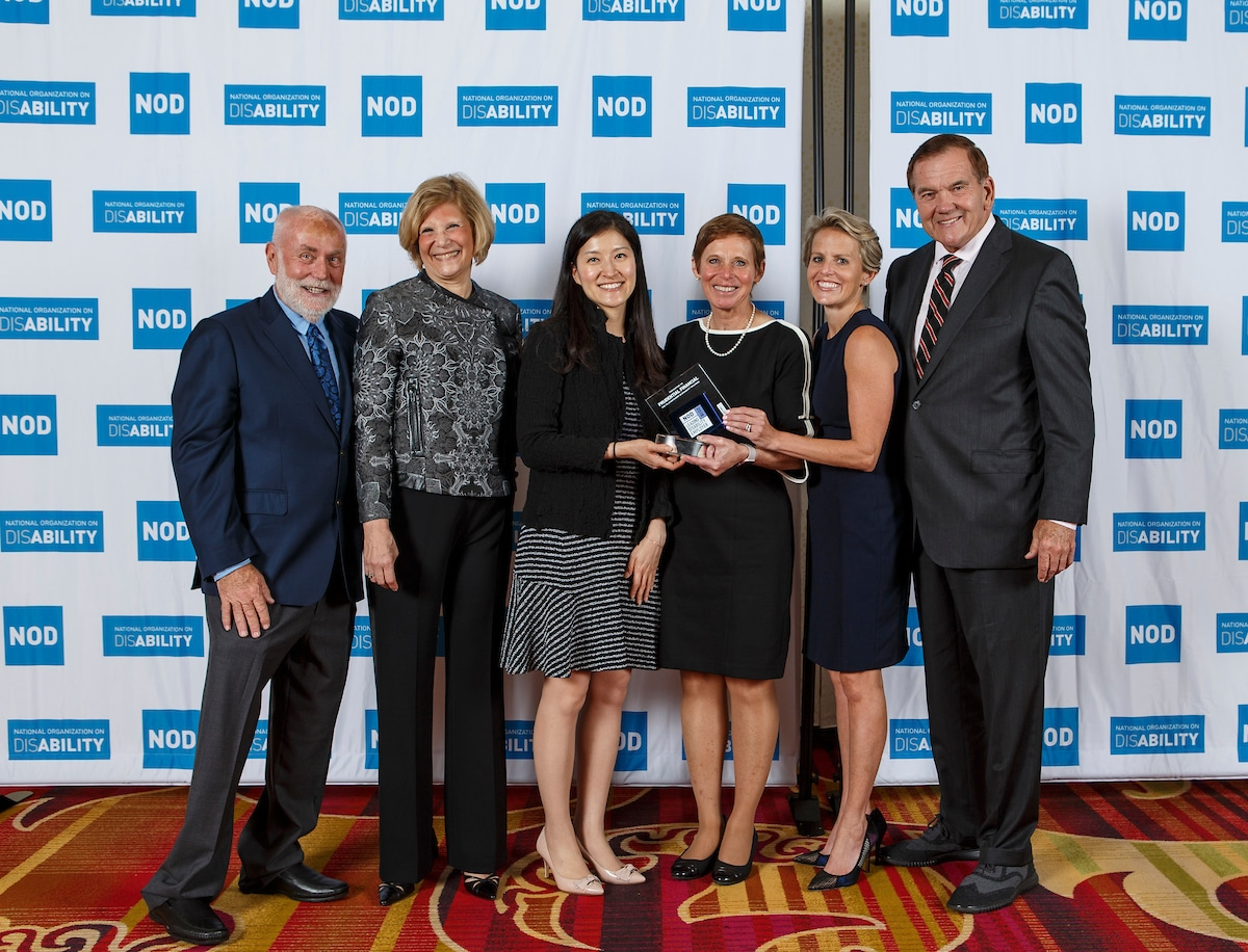 Prudential Financial's Diane B. Hettinger, Kirsten Martinko and Sarah Keh, posing with the 2018 Leading Disability Employer award, with Gov. Tom Ridge, actor Robert David Hall and NOD President Carol Glazer