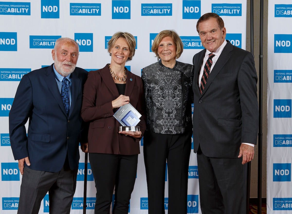 AT&T's Susan Diegleman, posing with the 2018 Leading Disability Employer award, with Gov. Tom Ridge, actor Robert David Hall and NOD President Carol Glazer