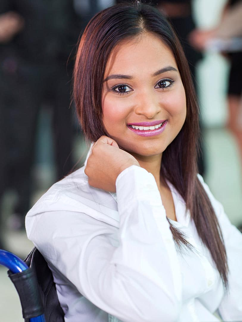 Young professional disabled woman, smiling at camera