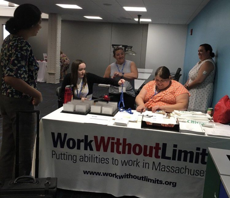 Staff at a table registering attendees.