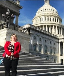Kayla McKeon posing in front of Capitol steps