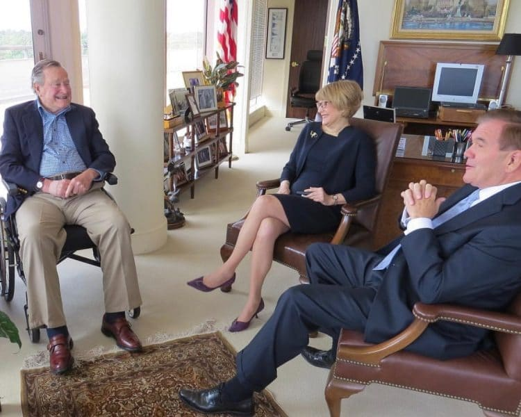 Pres. George H.W. Bush seated in his office, with NOD President Carol Glazer at center and Gov. Tom Ridge at right