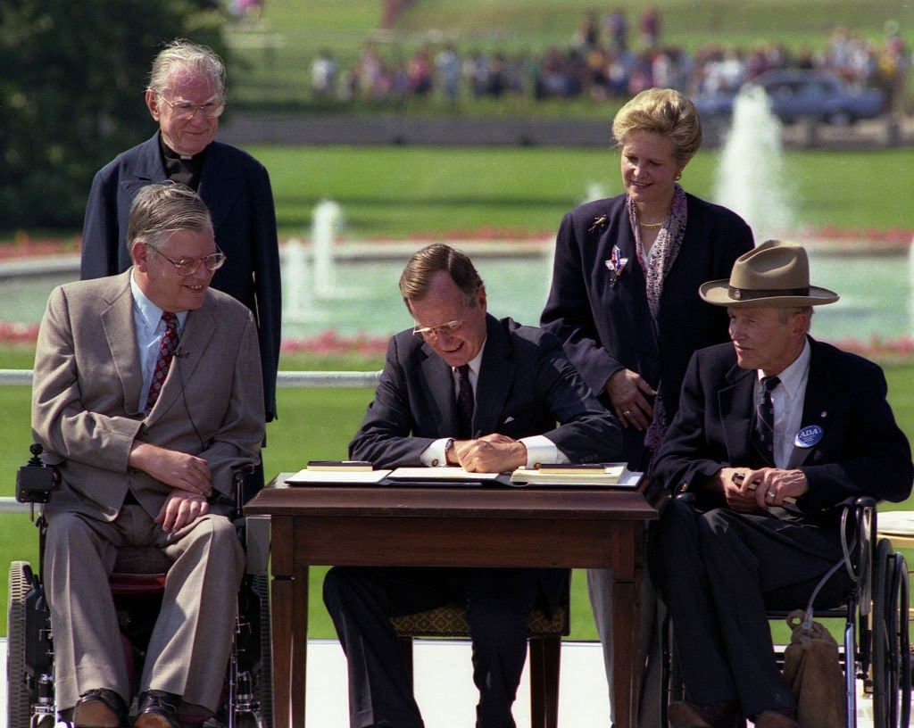 President Bush signs the ADA into law.