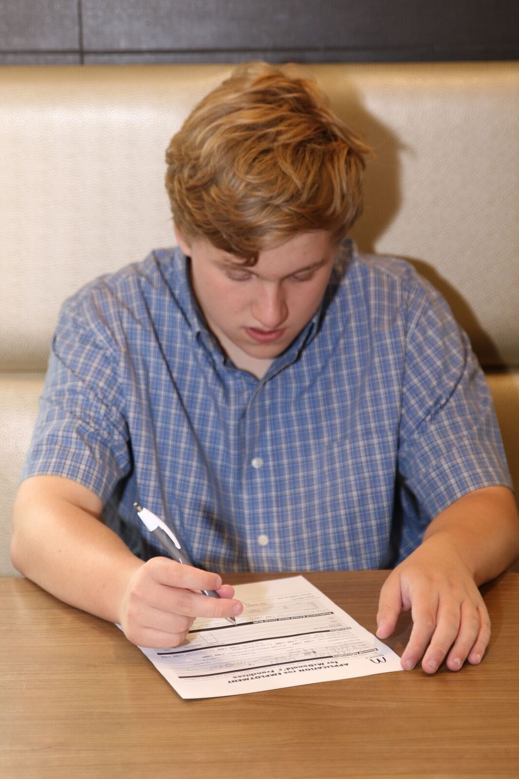Carter Dodd fills out his application to work at McDonald's.