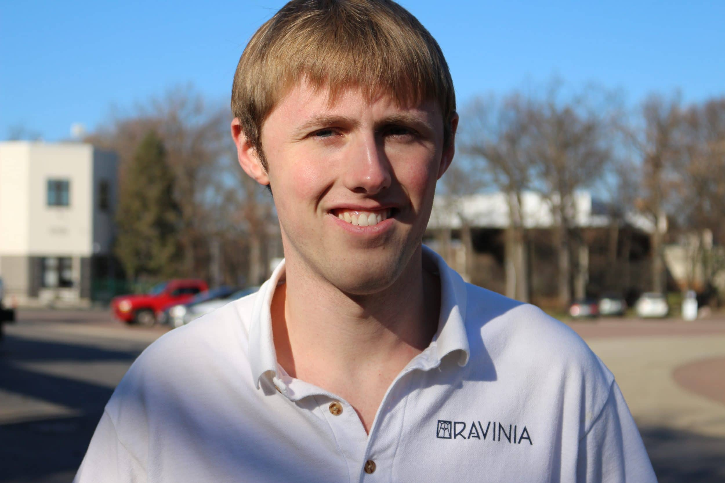 Headshot of Cole Nelson in Ravinia white polo shirt