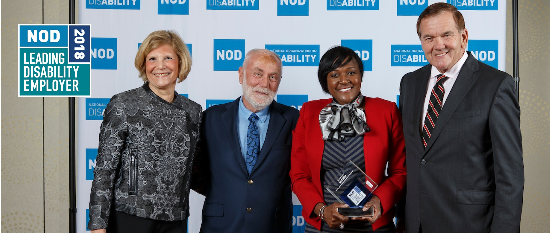 Leading Disability Employer Seal with photo of winners celebrating