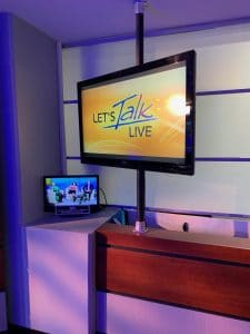 Let's Talk Live logo on a TV monitor