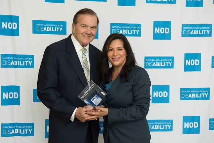 Gov. Tom Ridge, NOD's Chairman, awarding AJ Petross the 2017 NOD Leading Disability Employer Seal