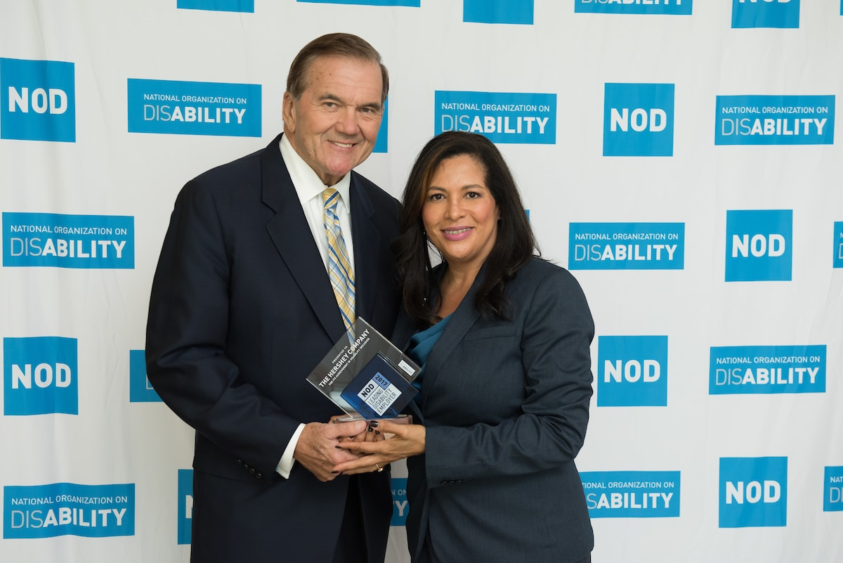 Gov. Tom Ridge, NOD's Chairman, awarding AJ Petross the 2017 NOD Leading Disability Employer Seal