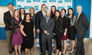Group photo of NOD staff with Gov. Tom Ridge