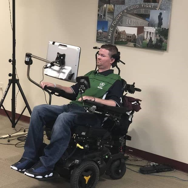 Pat Quinn in his wheelchair with eyetracking device