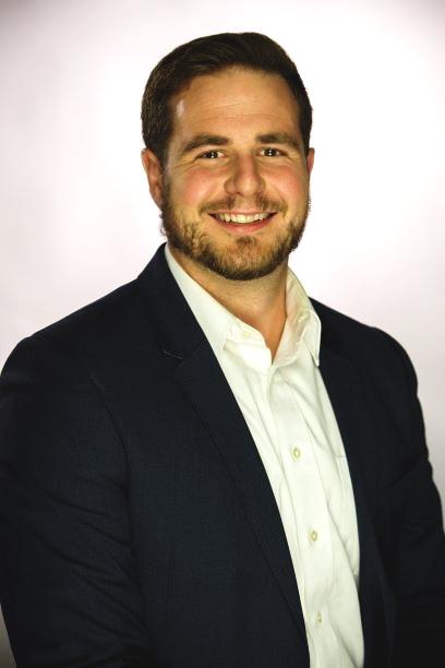 Headshot of Hunter Schwartz in dark blazer and white dress shirt.