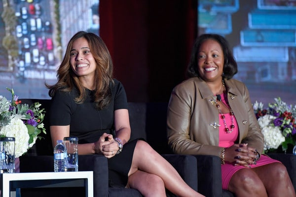 Rhonda Crichlow (right) speaking an a Women in Cable Telecommunications industry event