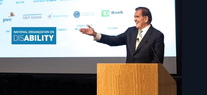 Gov. Ridge gesturing while speaking at a podium