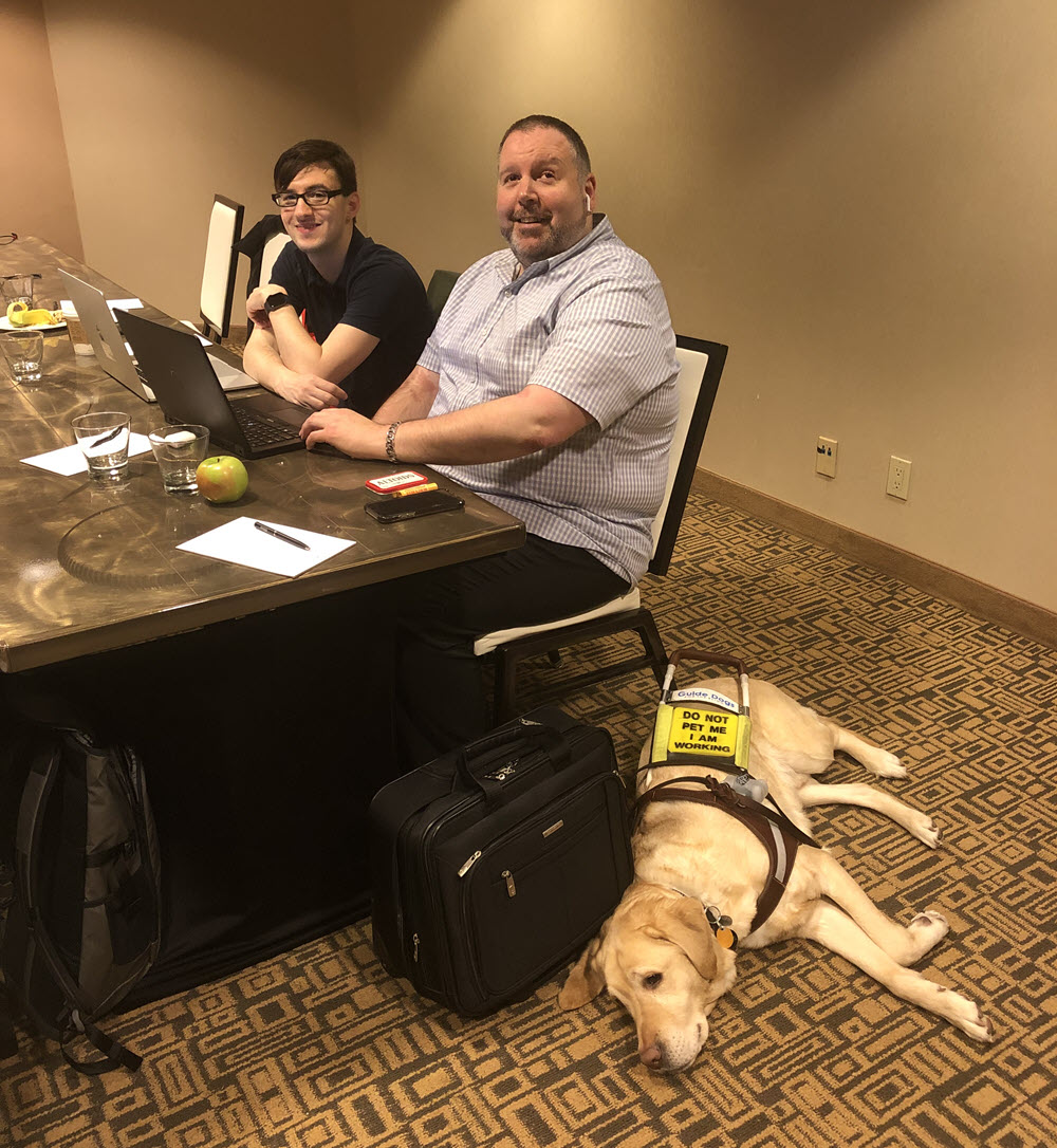 Steven Fontaine at work with his service dog