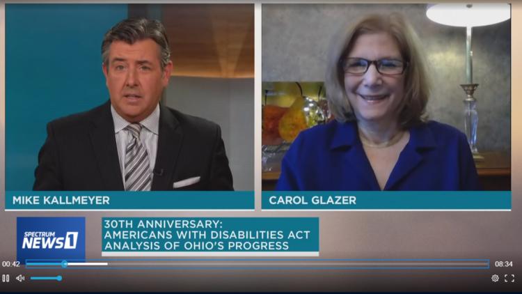 Carol Glazer in splitscreen with Spectrum reporter