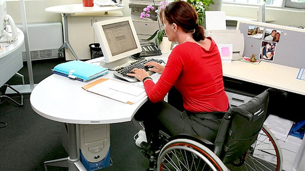 Woman in a wheelchair using a computer