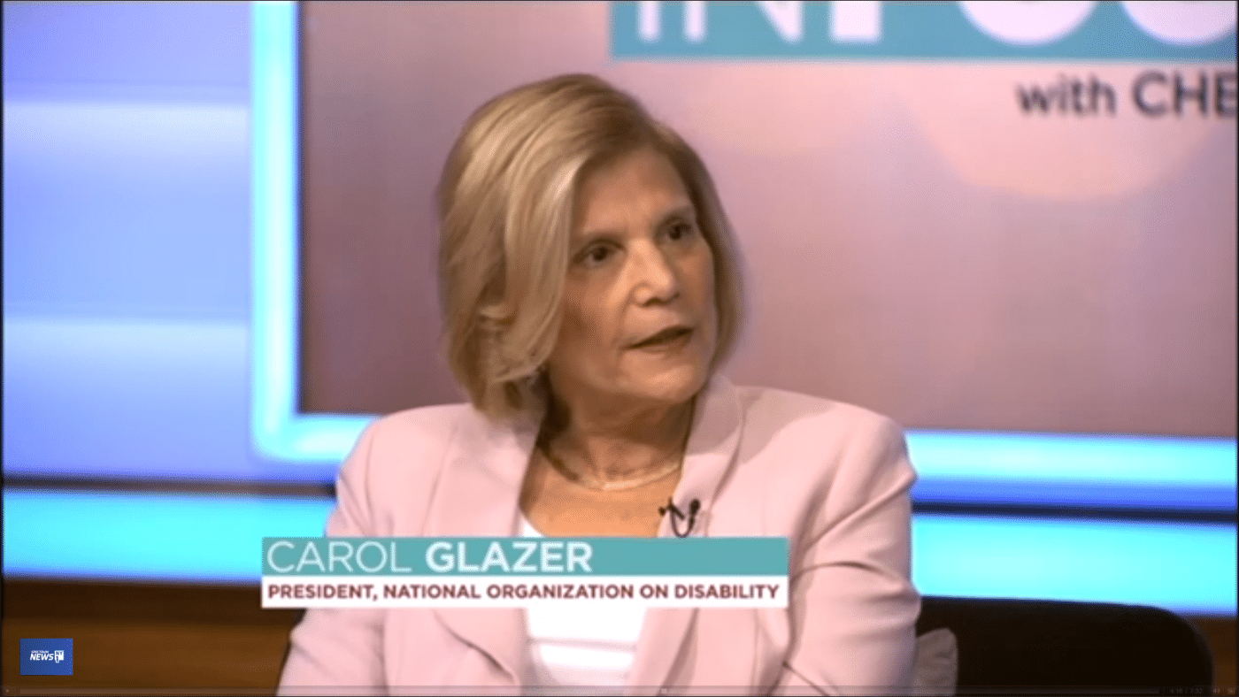 Video still of Carol Glazer speaking on set