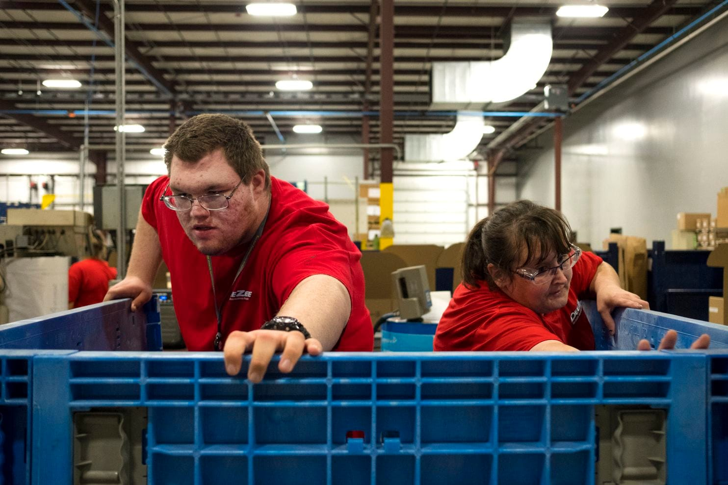 Channon and Miller open a crate at Dee Zee. More U.S. firms are partnering with local organizations that support people with disabilities to recruit them and hire leaders to monitor their retention. (Calla Kessler/For The Washington Post)