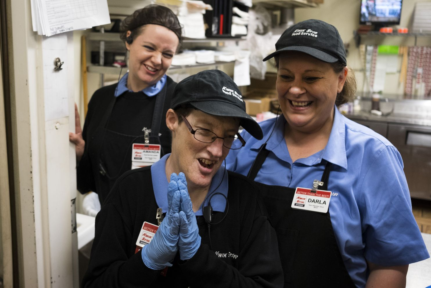 Julie Propp, 57, center, shares a laugh with her co-workers Amanda Torres, left, and Darla Tomlinson, right, at a Kwik Star convenience store in Marshalltown, Iowa. Kwik Star began hiring employees with disabilities when it became hard to find workers who could pass its background check. (Calla Kessler/For The Washington Post)